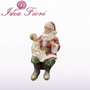 Babbo Natale seduto con...